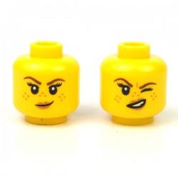 LEGO® - Yellow Minifig, Head Dual Sided Female Black Eyebrows, Peach Lips, Smirk / Smile with Dark Bluish Gray Mud Splotches